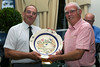 John  Nicholle on behalf of St Martin Parish accepts from Malcolm Cleal the award for Best Floral Display in 2014