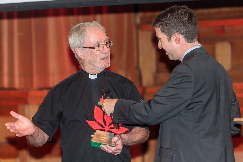 Rev. Richard Bellinger accepts the Youth Award on behalf of Katie Sheppard who has volunteered for many years at The Caritas Community Charitable Trust