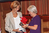 Dame Mary Perkins DBE presents Philippa Stahelin, Executive Director of Headway Guernsey, with the Innovation Award sponsored by Specsavers, at the 2017 Community Awards