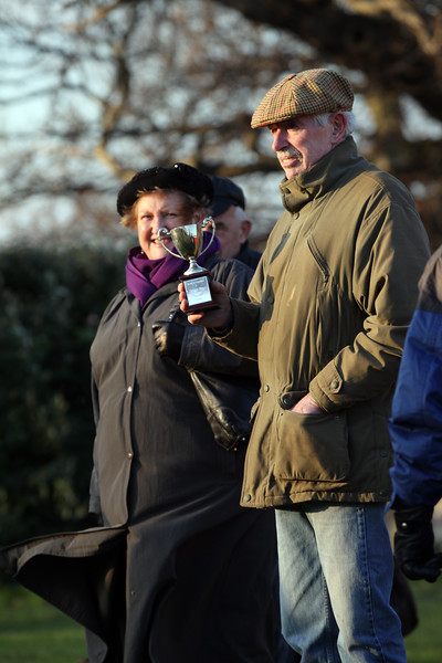 Deputy Jenny Tasker and Deputy Francis Quin watch the football match between the States of Guernsey and the Guernsey media at Cambridge Park on the 27 December 2008.  Deputy Francis Quin holds the trophy, which was won by the States of Guernsey.  Final score 4-1.