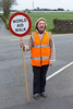 Volunteer assures road crossing safety during Guernsey World Aid Walk