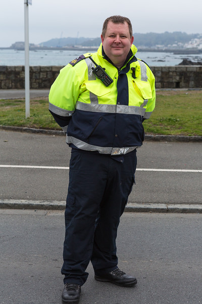 Dave Hodge of the Civil Protection Volunteers provides a safe road crossing for Guernsey World Aid Walk walkers