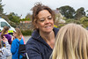 Make-up artist and face painter decorates children's faces at Guernsey World Aid Walk rest stop