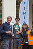 Guernsey World Aid Walk chair congratulates walkers at the finish