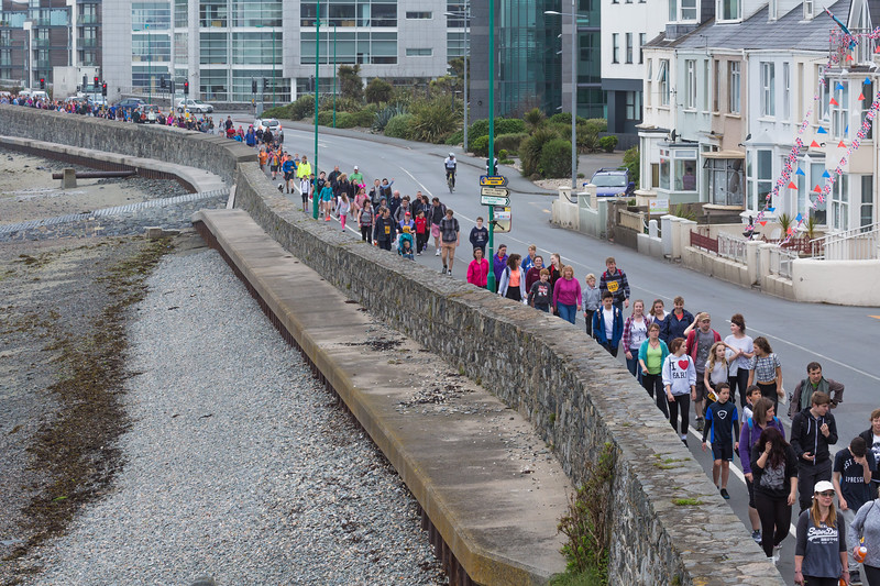 World Aid Walk walkers along the waterfront of Les Banques, Guernsey