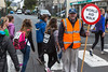 Volunteer makes road crossing safe during Guernsey World Aid Walk