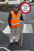 Volunteer helps Guernsey World Aid Walk walkers cross Vale Avenue safely