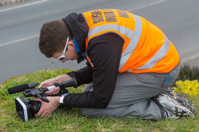 Olly Tracey filming the 2016 Guernsey World Aid Walk along Les Banques