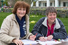 Volunteers register Guernsey World Aid Walk walkers outside the Vale Douzaine Room