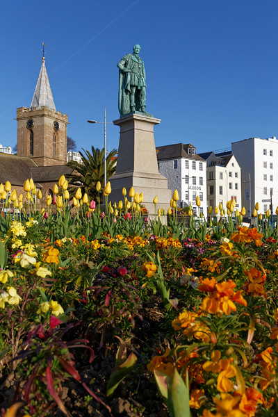 The Prince Albert Statue surrounded by flowerbeds in St Peter Port, Guernsey