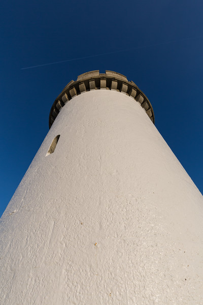 Castle Breakwater lighthouse against a blue sky