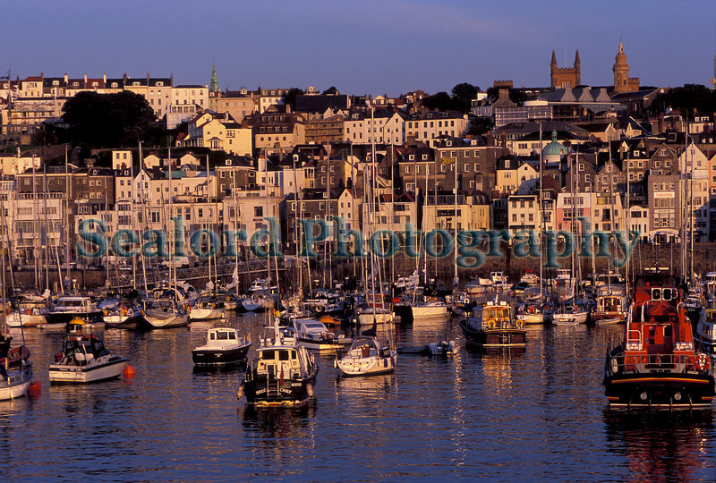 Early morning sun shining on the St Peter Port waterfront