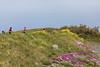 Saffery Champnress Rotary walkers follow the coastal path by Pulias Pond