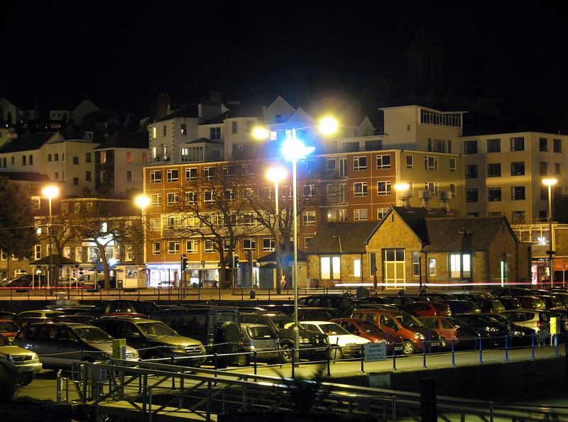 A view of a part of the St. Peter Port, Guernsey, Channel Islands, Great Britain waterfront on the night of 22 March 2008.  This image was taken exactly one week before Earth Hour when many of the lights of St. Peter Port were switched off for one hour to determine the saving of electricity.  This image was taken using a Canon A640 digital camera with a small plastic tripod.  The tripod was sheltered by a harbour wall as it was windy.<br /> File No. 220308 3844 <br /> ©RLLord<br /> fishinfo@guernsey.net<br /> Sealordphotography
