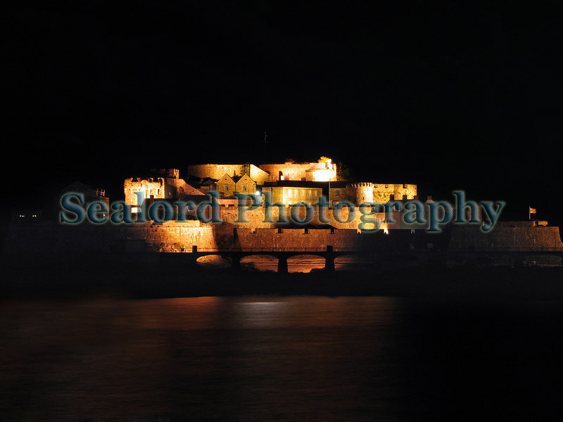The 1000 year old Castle Cornet which has been modified and enlarged many times dominates the entrance to St. Peter Port harbour in Guernsey.  Photographed at about 2200 on 1 November 2006.<br /> File No. 011106 4204<br /> ©RLLord<br /> fishinfo@guernsey.net
