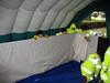 Civil protection TM tent peeking 020908 9032 RLLord smg