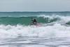 Adam Harvey surfs along wave front Petit Port 130216 ©RLLord 6755 smg