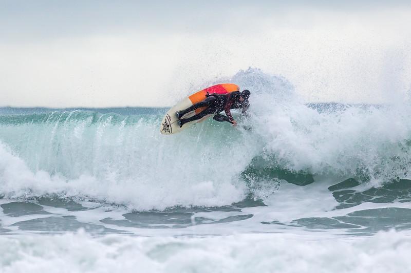 Adam Harvey on KS Waveski goes over rolling wave off Petit Port cr 130216 ©RLLord 6702 smg