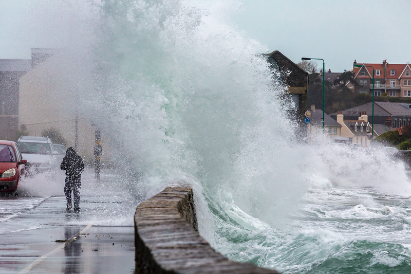 Wave crashes over pedestrian on Guernsey's east coast