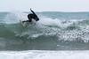 Dave Du Port digs into a wave off Petit Port, Guernsey