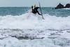 Adam Harvey paddling through surf Petit Port cr 130216 ©RLLord 6631 smg