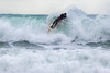 Adam Harvey on KS Waveski goes over rolling wave off Petit Port cr 130216 ©RLLord 6703 smg