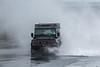 Landrover drives through spray Belle Greve Bay 100416 ©RLLord 9393 smg