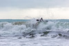 Adam Harvey splashes over top of wave off Petit Port 130216 ©RLLord 6714 smg