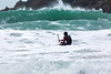 Adam Harvey KS Waveski paddling out to large waves Petit Port 130216 ©RLLord 6227 smg