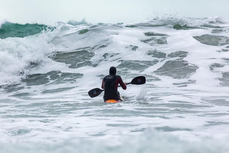 Adam Harvey paddling towards large wave Petit Port 130216 ©RLLord 6207 smg