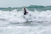 Adam Harvey powers  through the surf on his KS Waveski