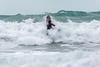 Adam Harvey powers  through the surf on his KS Waveski