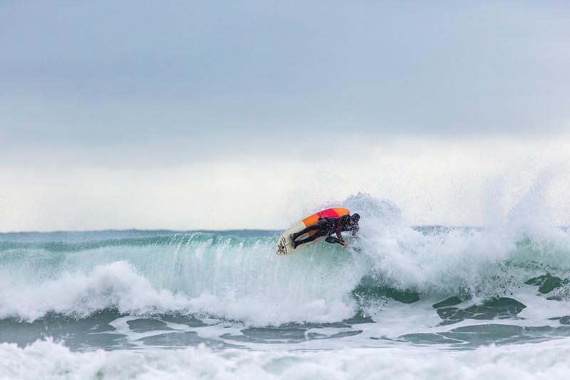 Adam Harvey on KS Waveski goes over rolling wave off Petit Port 130216 ©RLLord 6702 smg