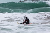 Adam Harvey KS Waveski paddling out to large waves Petit Port 130216 ©RLLord 6231 smg