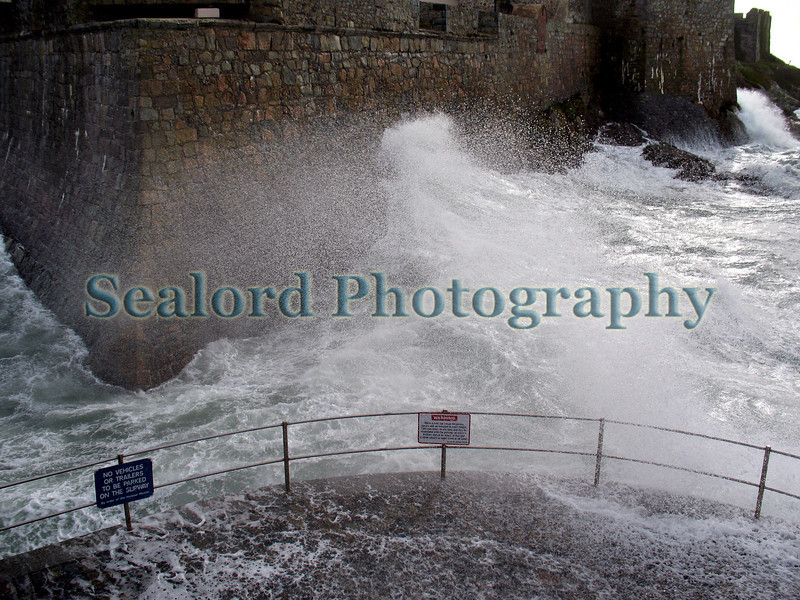 A wave surging up the wall of the north-west corner of Castle Cornet, St Peter Port on 10 March 2008.<br /> <br /> File No. 100308 3622<br /> ©RLLord<br /> fishinfo@guernsey.net<br /> sustainableguernsey@gmail.com