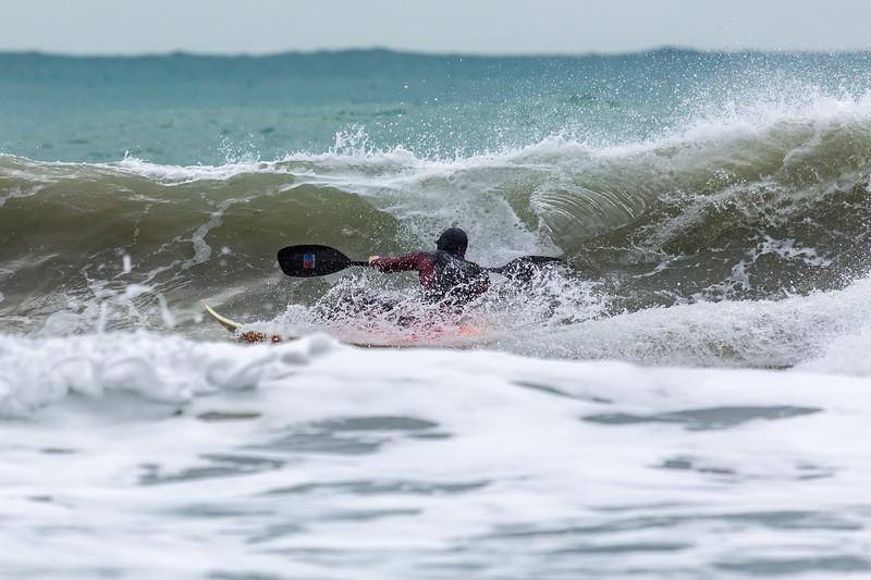 Adam Harvey surfs along wave front Petit Port 130216 ©RLLord 6770 cr smg
