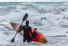 Adam Harvey with KS Waveski entering water Petit Port 130216 ©RLLord 6182 smg