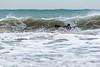 Adam Harvey paddles along a wave on his KS Waveski