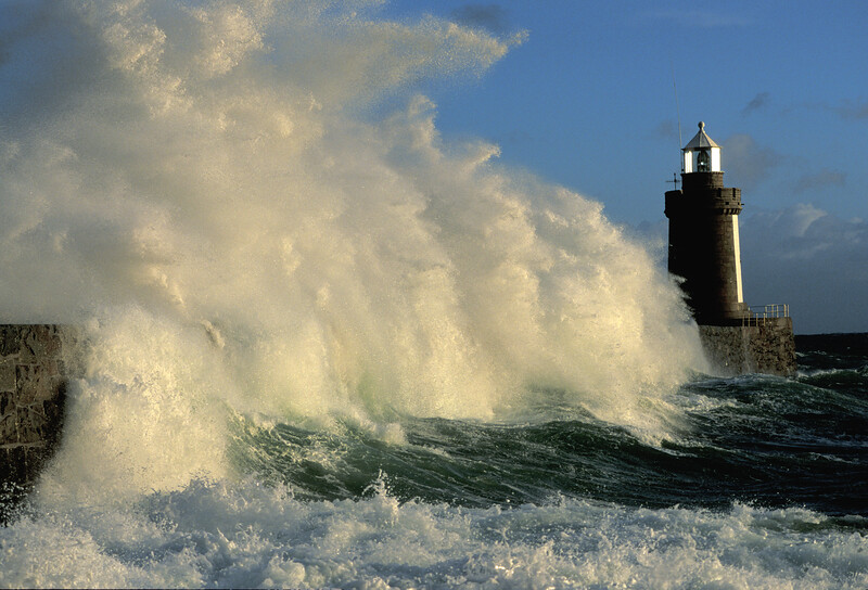 Strong southerly winds cause a large wave to surge over Castle breakwater, St. Peter Port harbour, Guernsey at 9 a.m. on 2 December 2005.<br /> File No. 10-805<br /> ©RLLord<br /> fishinfo@guernsey.net