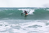 Adam Harvey rides down a wave on his KS Waveski
