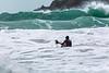 Adam Harvey KS Waveski paddling out to large waves Petit Port 130216 ©RLLord 6229 smg