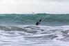 Adam Harvey paddling out from Petit Port on his KS Waveski