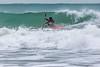 Adam Harvey surfs along wave front Petit Port 130216 ©RLLord 6755 cr smg
