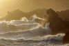 Waves arrive on Guernsey's south coast in late afternoon sunshine