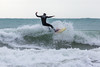 Dave Du Port surfing at crest of wave off Petit Port cr 130216 ©RLLord 6717 smg