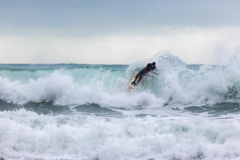 Adam Harvey on KS Waveski goes over rolling wave off Petit Port 130216 ©RLLord 6703 smg