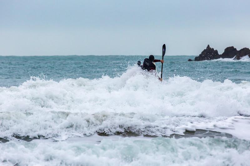 Adam Harvey paddling through surf Petit Port 130216 ©RLLord 6632 smg
