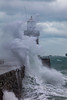 Wave breaks over Castle Breakwater at the entrance to St Peter Port harbour