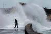 Belle Greve Bay wave overtops walker 100416 ©RLLord 9543 smg