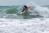 Adam Harvey goes down the face of a wave on his KS Waveski
